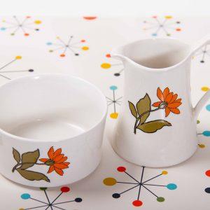 A Burleigh Ware milk/cream jug and sugar bowl set with orange flower pattern on. Circa 1950's