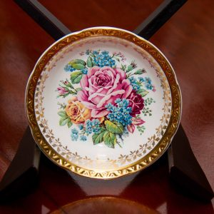Weatherby Hanley Royal Falcon Ware small dish. With embossed gold edge and large rose pattern.