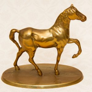 brass horse cantering ornament