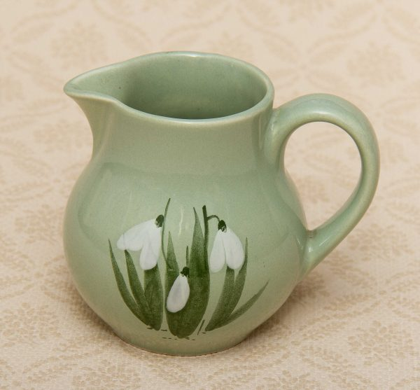 Holkham Studio Pottery small green jug with a hand painted snowdrops