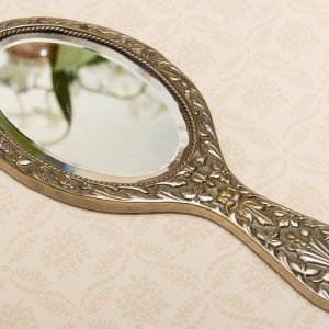 A quality vintage silver plated ornate hand vanity mirror. The mirror is a good weight and has a bevel edge mirror.