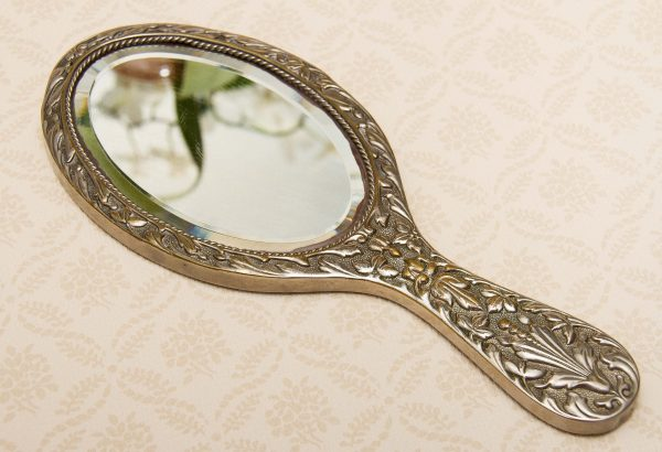 A quality vintage silver plated ornate hand vanity mirror. The mirror is a good weight and has a bevel edge mirror., Vintage Ornate Silver Plated Hand Mirror Vanity beveled edge oval mirror with handle dressing table mirror