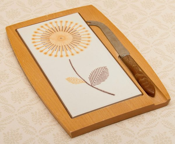 A vintage cheese board and knife set., Wooden and ceramic vintage cheese board set with matching Sheffield stainless steel cheese knife Mid Century Modern Sunflower pattern